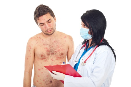 Doctor woman with mask giving prescription to a sick patient man with chickenpox isolated on white background photo