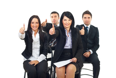 Successful people at the conference sitting on chairs and giving thumbs up isolated on white background photo