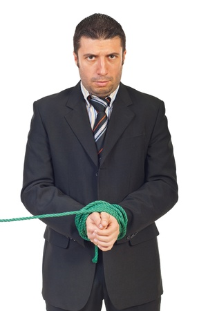Nervous business man with hands tied looking at camera isolated on white background photo