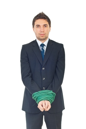 Sad executive man having his hands well linked looking at camera isolated on white background photo
