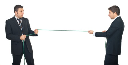 Business men pulling rope in a competition isolated on white background photo