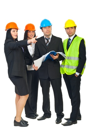 Full length of four constructors architects with blueprints pointing and looking up to a future contruction isolated on white background photo