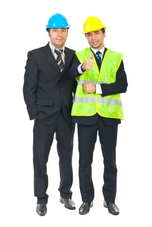 Successful team of two engineers men with helmets isolated on white background Stock Photo - 8375503
