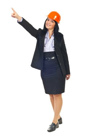 Full length of architect woman  pointing up and looking at camera isolated on white background Stock Photo - 8375496