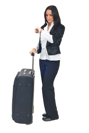 body check: Business woman with luggage waiting and looking wristwatch checking time isolated on white background