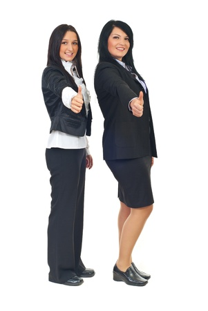 Full length of two business women giving thumbs up isolated on white background Stock Photo - 8375535