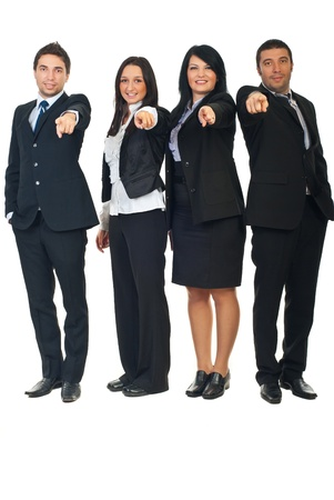 Full length of four business people in a row pointing  and chosen you to join their business isolated on white background photo