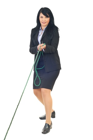 Full length  of business woman pulling rope in tug of war game isolated on white background Stock Photo - 8375528