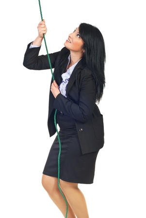 Smiling business woman trying to climbing a rope and aspirate to success isolated on white background Stock Photo - 8375537