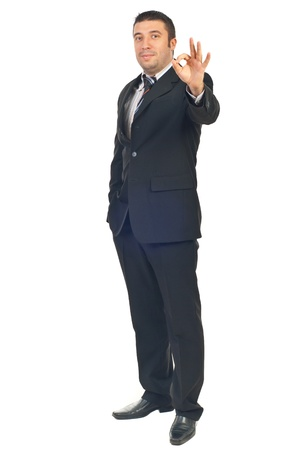 Full length of happy employee showing okay sign hand gesture isolated on white background Stock Photo - 8407893
