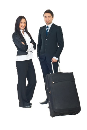 Full length of two business people prepare to go in a business travel isolated on white background photo