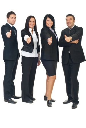 Full length of four business people in a row giving thumbs up isolated on white background photo