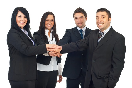 Happy united group of four business people in formal wear standing with their hands together  isolatedon white background photo