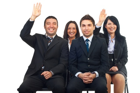four hands: Business people at course or auction raise hands  and laughing