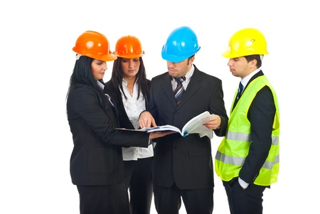 executive helmet: Group of four constructor engineers team examine their blueprints and having discussion isolated on white background