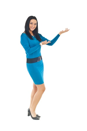 Full length of attractive woman in blue tight dress making presentation to copy space isolated on white background photo