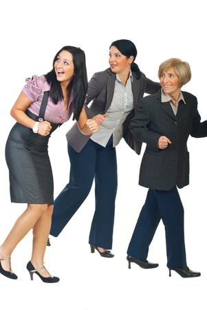 Profile of three business women running away  from something and looking back with happy faces isolated on white background photo