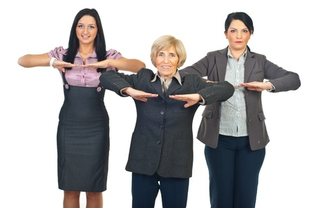 Group of business women doing fitness before starting their work isolated on white background Stock Photo - 8435986
