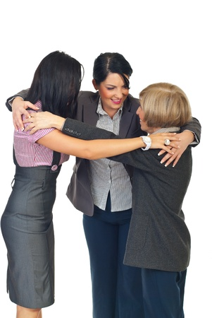 Thre business women standing  in a circle  embrace and having conversation togheter isolated on white background Stock Photo - 8436004