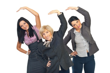 senior exercising: Three active business women stretching their hands isolated on white background