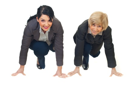 Two business women young and senior at start line ready for competition isolated on white background Stock Photo - 8435948