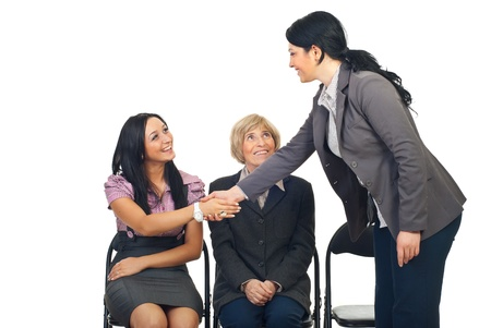 acquaintance: Business woman congratulate her young colleague woman isolated on white background