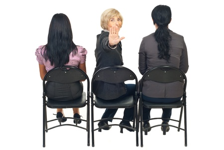 Three executive women at presentation with one senior women  return to showing a stop hand Stock Photo - 8435976