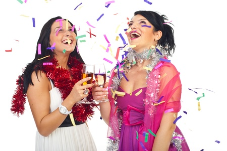 Two laughing women at party celebrating with champagne and confetti  photo