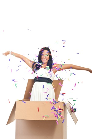 Beautiful woman out of the box at party  with confetti falling down photo