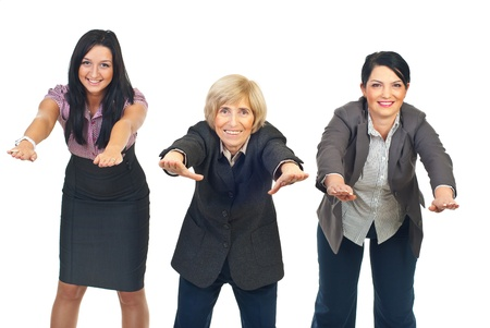 Three active businesswomen in a row doing exercises isolated on white background Stock Photo - 8436024