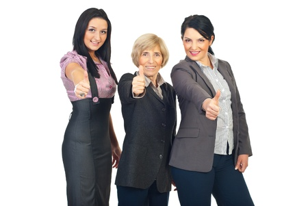 Group of beautiful business women giving thumbs up isolated on white background Stock Photo - 8436025