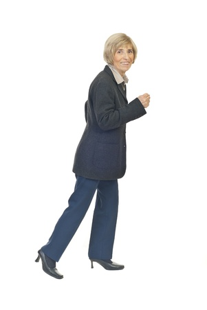Senior business woman running and looking you isolated on white  background Stock Photo - 8491958