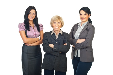 mains crois�es: Three smiling business women standing in a row with hands crossed isolated on white background Banque d'images