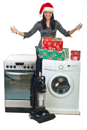 Young woman with Santa hat making Christmas peomotion at household appliances isolated on white background photo