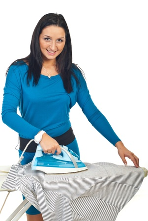 woman ironing: Smiling young woman ironing a shirt and looking at camera isolated on white background