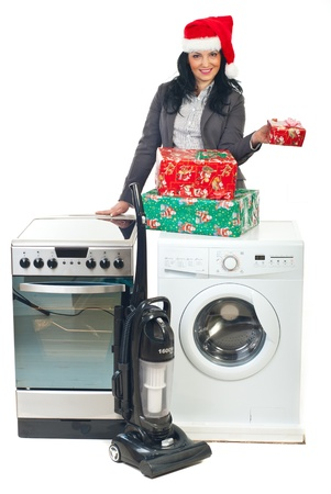 Beautiful woman with Santa hat offering household appliances  at promotion and holding Christmas gifts photo