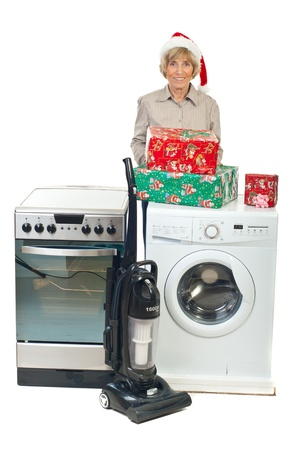 Senior woman make Christmas promotion at household appliances isolated on white background photo