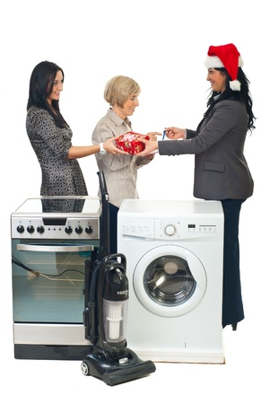 Woman with Santa hat make a special delivery to a family with household appliances photo