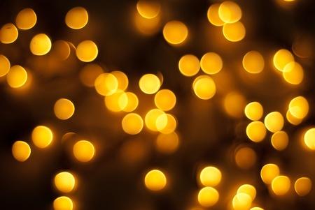 Orange Christmas  tree lights in night background photo
