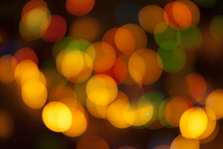 Defocused Christmas tree lights in different colors  background Stock Photo
