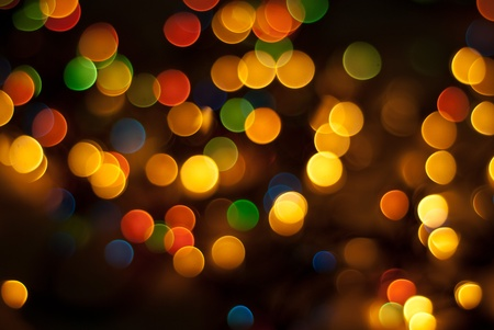 Beautiful Christmas tree lights in different colors background photo