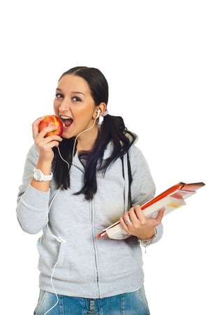 sound bite: Healthy student girl preparing to bite an apple and holding notebooks  isolated on white background Stock Photo