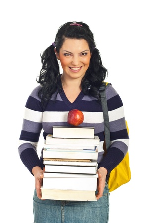 Happy student woman holding pile of books and an apple and smiling isolated on white background Stock Photo - 8586092
