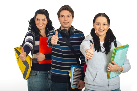 Successful group of students standing in a row and giving thumbs up isolated on white background photo
