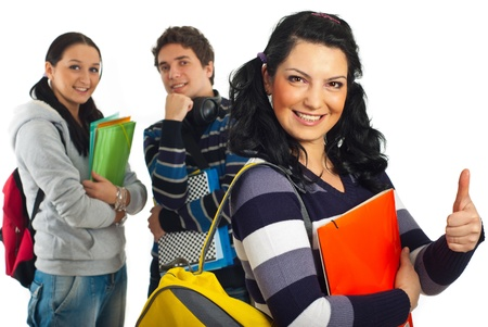 Happy student female giving thumb up and her colleagues smiling in background Stock Photo