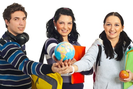 Three cheerful students standing with their hands together and holding a globe in center isolated on white background