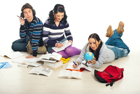 Three students sitting on floor  and doing their homework together Stock Photo - 8586153