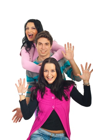 Excited three friends standing in a row and showing their palms isolated on white background photo