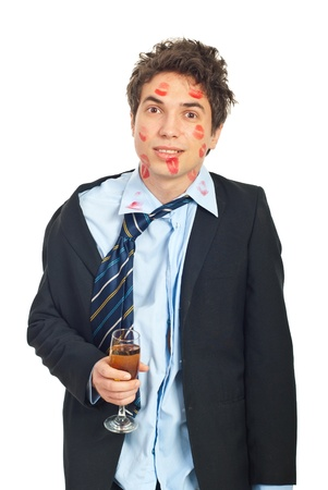 unfaithful: Kissed lover man being drunk and  holding a glass with alcohol and smiling isolated on white background Stock Photo