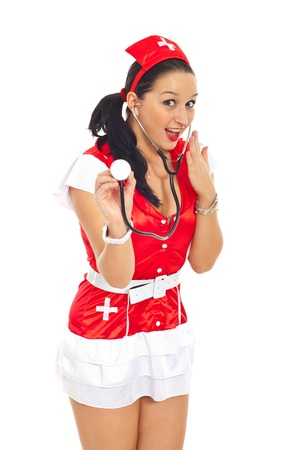 Surprised sexy nurse in red-white uniform holding a stethoscope isolated on white background Stock Photo - 8585723